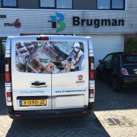 Marc Veken zijn nieuwe bus met op de achterkant een mooie actiefoto van zichzelf!